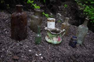 Old bottles, and pottery found at cellar holes.